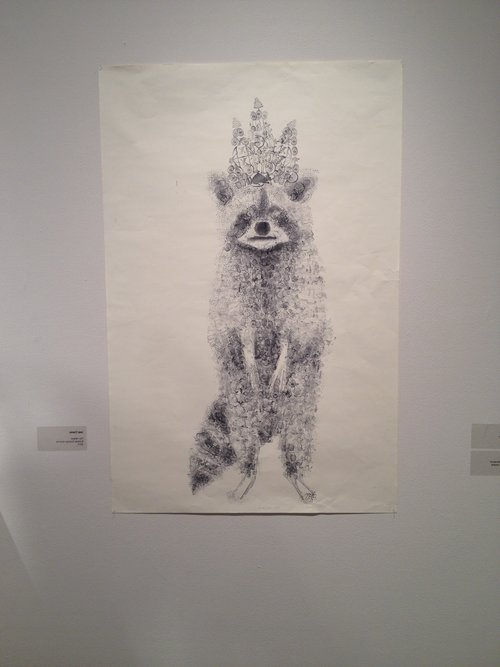 This is a raccoon made out of stamps, named The Helper.
