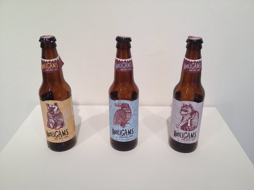 This is Hooligans Hard Apple Cider. Labels created by Lea Carey.