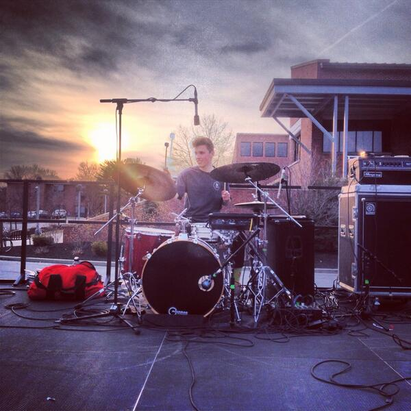 Alex Sowinski of BADBADNOTGOOD plays in front of an epic sunset.  Photo by Matt Schonfeld